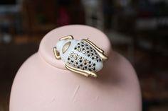 "30s bakelite ""scarab"" brooch by PatriciaLouvradoux on Etsy https://www.etsy.com/listing/127025123/30s-bakelite-scarab-brooch"