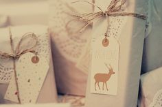 Inexpensive ideas:  wrapping gifts with doily paper and twine
