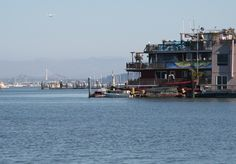 Sausalito houseboats and the new Bay Bridge in the background. Marin County, CA
