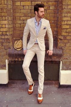 Creamy coloured suit, blue/white t-shirt, brown shoes with a black belt