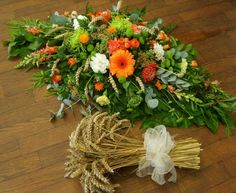 Coffin spray for funeral made with wheat for a farmer, limes and oranges with gerbra blooms protea carnations and more, beautiful, made here at florist @ the swan