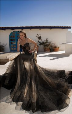 The stunning Neptune Gown from Galia Lahav. #black #dress #gown #evening http://www.weddingchicks.com/2014/07/11/galia-lahav-la-dolce-vita/