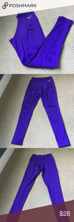Bright purple Nike pro dri fit fleece lined tights Worn once. Unique stitching and fleece lined. Perfect condition! Nike Pants Leggings