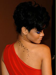 Rihanna has the illest tattoos... and while I'm at it, she's too damn fine!