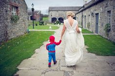 Surprise and ring bearer change into his fav super hero costume/pajamas and flower girl into a princess costume/pajamas for the reception? So cute!