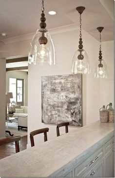 Stunning light fixtures in this kitchen this whole look is fabulous !