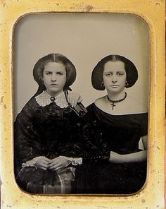 Mid to late 1850's . ¼ plate ambrotype of 2 young women. Amazing ratted hair. Beautiful lace square collar, perhaps (watersilk taffeta?) sacque bodice.