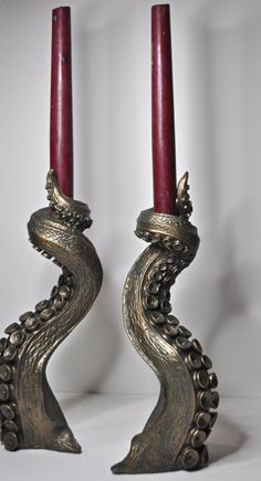 "10"" candlestick Holders   Representing the unknown perils of murky ocean depths and those beyond the mundane world, the tentacle hails from Lovecraftian horror and ancient tales of sea monsters.   cas"