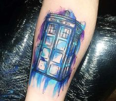 Watercolor tattoo style of Tardis from the tv series Doctor Who done by tattoo artist Kerste Diston Dr Who Tattoo, Doctor Who Tattoos, Get A Tattoo, Arm Tattoo, Body Art Tattoos, Sleeve Tattoos, Colour Tattoos, Thigh Tattoos, Tatoos