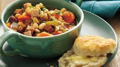 Slow-Cooker Smoky Ham and Navy Bean Stew Every spoonful of this slow-cooker soup is loaded with ham, beans and vegetables. Crock Pot Slow Cooker, Crock Pot Cooking, Slow Cooker Recipes, Crockpot Recipes, Cooking Recipes, Soup Recipes, Yummy Recipes, Dinner Recipes, Recipes
