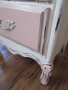 Close up of the distressing, annie sloan chalk paint in pure white and antoinette. Sealed with clear wax.