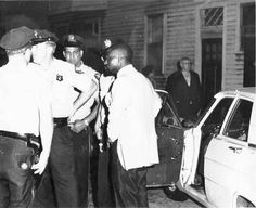 "Rubin ""The Hurricane"" Carter at the Lafayette Bar, Paterson, New Jersey - ""After they apprehended Rubin Carter and John Artis, the police escorted the men - in their car - back to the crime scene at the Lafayette Bar and Grill. This photograph depicts Carter at the scene, at that time."" [1966]"