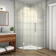 Add a desirable contemporary style to your corner space with the Neoscape completely frameless neo-angle shower enclosure.  The Neoscape will instantly upgrade to luxury with 3/8-inch tempered glass, premium hardware and a two-tiered shelf system.