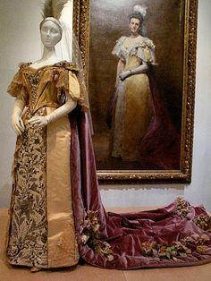 Dress worn by Emily Warren Roebling for her presentation to the Queen in 1896, with a portrait of herself in that dress by Emile Carolus-Duran.