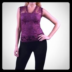 Purple floral lace top A top that never goes out of style, Floral Lace Overlay V Neck Top in a glamorous purple shade is an enchanting piece of clothing. The polyester made top features a V neck design and sleeveless pattern for a chic summer look. The scalloped lace detailing is extremely beautiful and desirable while the intricate self textured floral design on the fabric is amazing. With sheer front yoke and back design, the lacy top is elegant and a must-have. Tops