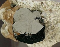 Bixbyite with Topaz Thomas Range, Juab County, Utah, USA Crystal size: 1.2 × 1.1 cm. Photo: Reference Specimens Detail (Author: Jordi Fabre)