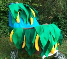 Your little monkey can swing right in the comfort of his own seat and nosh on bananas in a bright jungle of a costume like this one. Source: Etsy seller MapleTree2000