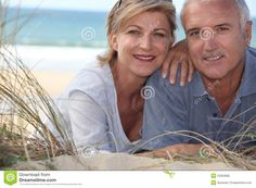 middle age couple photography | Couple Lying In The Sand Dunes