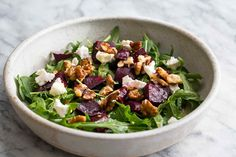 Arugula salad with beets, goat cheese, walnuts and a simple vinaigrette.