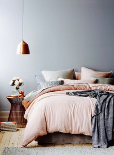 pink and grey muted tones with copper accents to make any bedroom space look homely and cute.