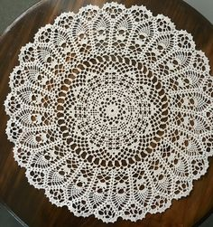 A personal favourite from my Etsy shop https://www.etsy.com/au/listing/476602047/cream-filet-and-pineapple-crochet-doily