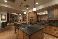 The custom kitchen was exquisite. Honed granite counters, slate tile backsplash with metal accents. The island stepped up to a solid butcher block counter.