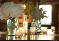 here are the jars with flowers in them.... we can so do this for your wedding.... each table can look different