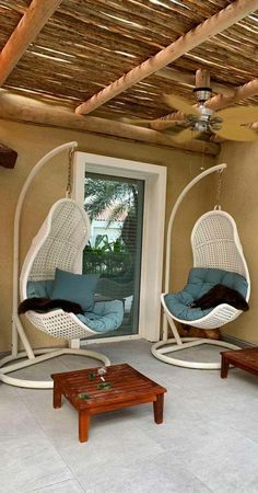 Add some contemporary swing chairs in a peaceful corner to create a blissful spot that's perfect for reading, relaxing or have your morning coffee. Outdoor Seating Areas, Outdoor Living Areas, Living Spaces, Living Room Decor, Timber Pergola, Wooden Pergola, Thatched Roof, Pergola Shade, Moda Masculina