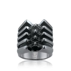 A hematite metal ring with 5 tiers/rows. Tiers are grooved to give definition…