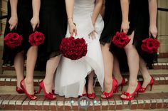 Lovin' the red shoes and bouquets with the black bridesmaids dresses!