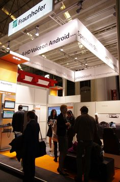 Our booth at Mobile World Congress where we are presenting Full-HD Voice and Extended HE-AAC Mobile World Congress, Company Logo