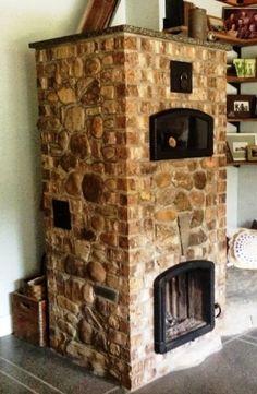 Love this masonry stove/pizza oven.