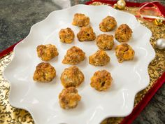 Cheesy Sausage Snacks : These bite-sized snacks combine cheddar, spicy sausage and hot sauce for a tasty treat that takes only 30 minutes to make.
