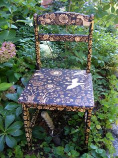 custom small chair-emblazoned with an ooak night forest design-flower-bird-star- leaves- rustic modern hand decorated furniture. $2,500.00, via Etsy.