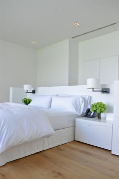 mb residence, white bedroom, headboard and nightstands