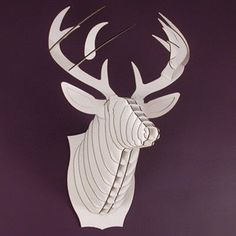 I don't like the look of real dead animal heads on the wall, this is a cute substitute - no animals harmed! Buck Jr.- Medium Deer Trophy- White. $30.00, via Etsy.