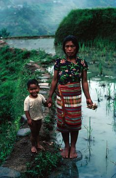 Portrait in rice paddies, Philippines  Environmental-portrait of mother and child in rice paddies.    by  John Maier Jr