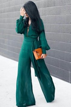 59f86651016e Wow - how dramatic is this gorgeous teal colored jumpsuit. Love this street  style.
