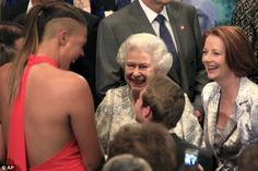The Queen enjoyed meeting someone as tall as Miss Cambage and introduced her to Prince Philip
