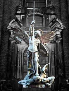 Archangel Michael's victory over the Devil, sculpture above the main entrance at St. Michaelis Church, Hamburg