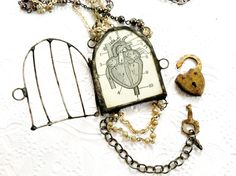 Caged Heart Necklace, Vintage Assemblage Necklace, Anti Valentines Day Necklace, Lock and Key Reliquary Cage Necklace, Heart In A Cage Neckl. $150.00, via Etsy.