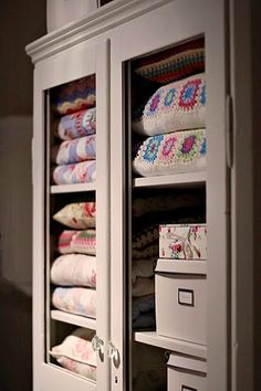colorful cupboard via http://norskeinteriorblogger.blogspot.com