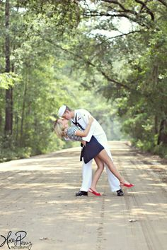 "Reminds me of that old photograph ""The Kiss"" even though the pose is slightly different. This could also be a cute idea for army or air force - finding a vintage uniform for the groom/male and then doing a pin-up vintagey look on the bride/female..."
