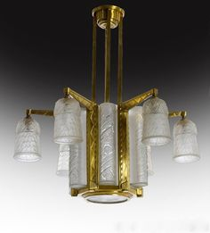 An Art Deco gilt-bronze and glass chandelier, Schneider glass works, France circa 1930.