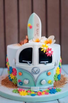 Hippie-surf cake design with VW camper van, made with chocolate, cream cheese and blackberries.