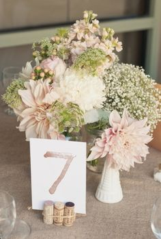 cute table numbers.  could make easily with watercolors and corks with twine