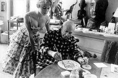 Brigitte Bardot looking over Pablo Picasso's shoulder at his studio. (1956)