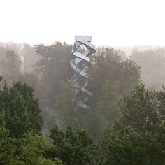 This observation tower by Munich office terrain:loenhart&mayr rises over the river Mur at the Austrian border with Slovenia. The aluminium-clad structure staircase curls back on itself at the top, forming a double spiral so that visitors on the way up pass those on the way down. Here's some more information, written by Lilli Hollein: Up