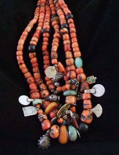 Morocco | Ancient 3 row necklace combining coral, amber, amazonite and old silver coins and charms | Draa valley, in the south | Sold.
