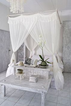 Canopy-bed-37You can see how the canopy is made from dowels hung from cord. Simple curtain panels are tied onto the canopy frame. I think the trick to a look like this is in choosing a romantic, flowy fabric.